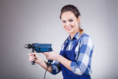 Smiling woman with drill Stock Photo