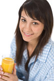 Smiling woman drink orange juice in pajamas Royalty Free Stock Photography