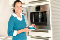 Smiling woman drinking cappuccino kitchen machine cup Stock Photos