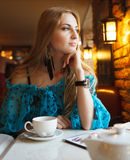 Smiling Woman Drinking Coffee Stock Image