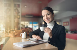 Smiling woman drinking a coffee Royalty Free Stock Image