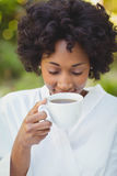 Smiling woman drinking coffee Stock Images