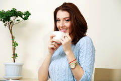 Smiling woman drinking coffee Royalty Free Stock Photo