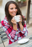 Smiling Woman Drinking Coffee Royalty Free Stock Photos