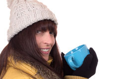 Smiling woman drinking a cup of hot tea in winter Stock Image