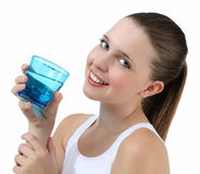 Smiling woman drinking a glass of water Stock Image