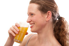 Smiling Woman drinking juice Royalty Free Stock Image