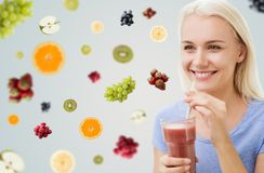 Smiling woman drinking juice or shake at home Stock Photo