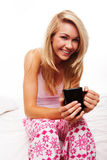 Smiling woman drinking morning coffee Stock Image