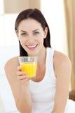 Smiling Woman Drinking Orange Juice Stock Image