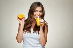 Smiling woman drinking orange juice with glass. isolated portrai Stock Images