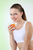 Smiling woman drinking orange juice vitamin Royalty Free Stock Photography