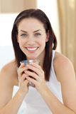 Smiling woman drinking tea Stock Images