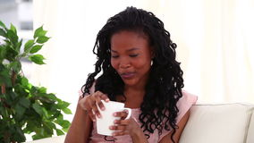 Smiling woman drinking a tea Royalty Free Stock Photography