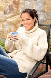 Smiling woman drinking tea patio sweater relaxing Stock Images
