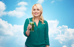Smiling woman drinking vegetable juice or smoothie Royalty Free Stock Photos