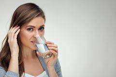 Smiling woman drinking water from glass. close up  face Stock Photo