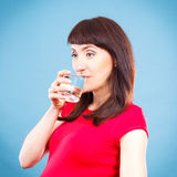 Smiling woman drinking water from glass, healthy lifestyle and hydration concept. Happy smiling woman drinking water from glass, concept of healthy lifestyle royalty free stock image