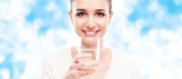 Smiling woman drinking water Royalty Free Stock Image