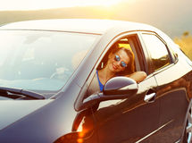 Free Smiling Woman Driving A Car At Sunset Stock Images - 60309524