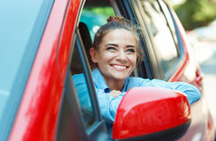 Smiling woman driving her car Stock Image
