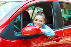 Smiling woman driving her car Royalty Free Stock Photos