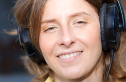 Smiling woman with earphones Royalty Free Stock Image