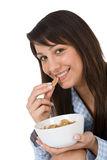 Smiling woman eat healthy cereal for breakfast Royalty Free Stock Photos