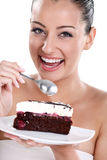 Smiling woman eating cake Stock Images