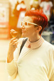 Smiling woman eating chocolate icecream Stock Photos