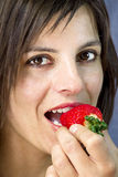 Smiling woman  eating greedy strawberry Stock Image