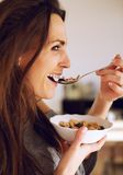 Smiling Woman Eating a Healthy Breakfast Stock Images