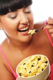 Smiling woman eating muesli Royalty Free Stock Images
