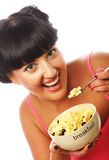 Smiling woman eating muesli Stock Photo