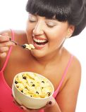 Smiling woman eating muesli Stock Images