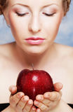 Smiling woman eating red apple Royalty Free Stock Image