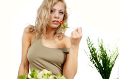 Smiling woman eating salad Royalty Free Stock Photo