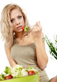 Smiling woman eating salad Stock Photo