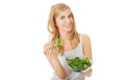 Smiling woman eating salat Stock Image