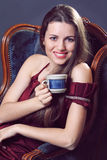 Smiling woman with a cup of coffee Royalty Free Stock Image