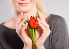 Smiling woman embracing flower. Royalty Free Stock Photos