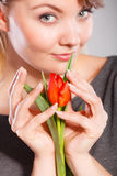 Smiling woman embracing flower. Royalty Free Stock Photo