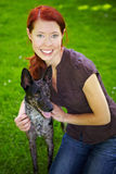 Smiling woman embracing her dog Royalty Free Stock Image