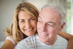 Smiling woman embracing man Royalty Free Stock Photos