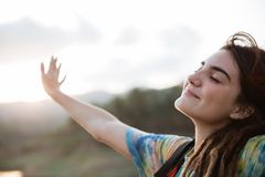 Smiling woman enjoy the morning and raise arm stock image