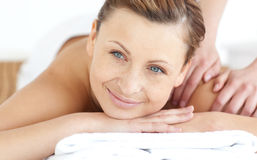Smiling woman enjoying a back massage Royalty Free Stock Image