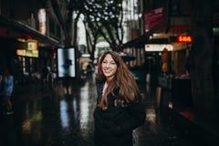 Smiling woman enjoying chinatown neighborhood in Sydney, Australia Stock Image