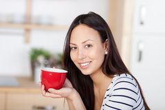 Smiling woman enjoying a cup of coffee Stock Photography