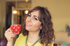 Smiling woman enjoying a cup of tea Royalty Free Stock Images