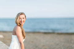 Smiling woman at seaside Stock Photos
